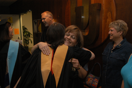 Helen Butler is congratulated for winning Staff Member of the Year shortly after Awards Day. - Photo by Jim Veneman